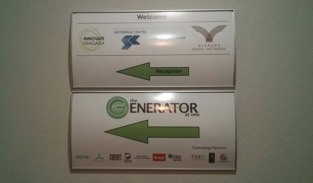 A sign indicating that Innovate Niagara, St. Catharines Enterprise Centre, and the Generator at One are nearby.